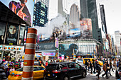 Times Square with steam pipe, yellow cab, traffic and tourists, Manhattan, New York City, USA, America