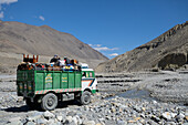 Indian Tata truck crossing the river in the Kali Gandaki valley, the deepest valley in the world, Mustang, Nepal, Himalaya, Asia