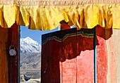 View through the door of the buddhist Gompa of Dzong, Jhong, village at the Annapurna Circuit Trek to Nilgiri (7061 m), Mustang, Nepal, Himalaya, Asia