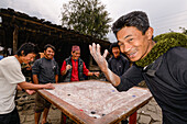 Young men playing Carrom, the Nepalese national sport, Nepal, Himalaya, Asia
