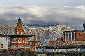 Tibetan monastery, gompa, stupa and chorten in Tsarang, Charang, tibetian village with a buddhist Gompa at the Kali Gandaki valley, the deepest valley in the world, fertile fields are only possible in the high desert due to a elaborate irrigation system,