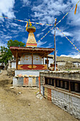Prayer wheels and stupa in Ghami, Ghemi, tibetian village with a buddhist Gompa at the Kali Gandaki valley, the deepest valley in the world, fertile fields are only possible in the high desert due to a elaborate irrigation system, Mustang, Nepal, Himalaya