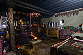 Kitchen and living room of a typical tibetan house in Nar, on the Nar Phu Trek, Nepal, Himalaya, Asia