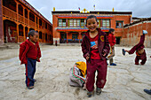 Novices, young monchs in Lo Manthang (3840 m), former capital of the Kingdom of Mustang and residence of the King Raja Jigme Dorje Palbar Bista in the Kali Gandaki valley, the deepest valley in the world, fertile fields are only possible in the high deser