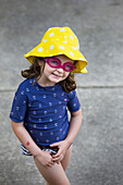 Caucasian girl wearing goggles and sun hat