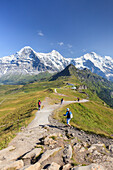 Hikers on the way to Mount Eiger, Mannlichen, Grindelwald, Bernese Oberland, Canton of Bern, Swiss Alps, Switzerland, Europe