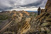 a man on U S Grant peak in the San Juan Mountains, Colorado.