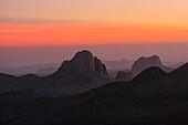 The Hoggar Mountains (Arabic: ???? ?????, Berber: idurar n Ahaggar, Tuareg: Idurar Uhaggar), also known as the Ahaggar, are a highland region in the central Sahara, southern Algeria, along the Tropic of Cancer. This mountainous region is located about 1,