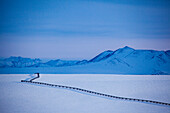 The Trans Alaska oil pipeline in wintertime at Brooks Range, North Slope Borough, Alaska, USA