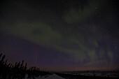 northern lights aurora borealis at Eagle Plains Lodge at the Dempster highway, Yukon, Yukon territory, Canada