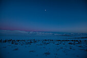 Richardson Mountains with moon in the dusk, near Dempster highway, Yukon, Yukon territory, Canada