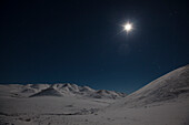 Starlit sky with moon into Richardson Mountains, at the Dempster highway, Yukon, Yukon territory, Canada