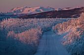 Morning light over snow-covered landscape at Dalton Highway, Yukon-Koyukuk Census Area, Alaska, USA