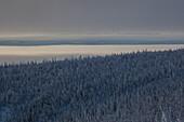 Snow covered landscape with morning fog at Dalton Highway, Yukon-Koyukuk Census Area, Alaska, USA