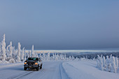 Pickup Truck on the Dalton Highway in snow covered landscape, Yukon-Koyukuk Census Area, Alaska, USA