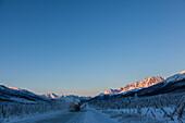 Truck at Dalton Highway in wintertime crossing Brooks Range, Yukon-Koyukuk Census Area, Alaska, USA