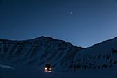 Truck at Dalton Highway in wintertime crossing Brooks Range, North Slope Borough, Alaska, USA