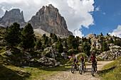 Mountain bikers at Langkofel, Trentino South Tyrol, Italy