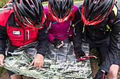 Mountain bikers with cycle helmet looking at a map, Mountain biking, MTB, Sport
