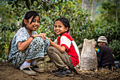 Smiling Indonesian children on a coffee plantation - Indonesia, Java