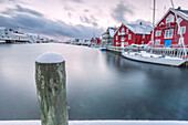 The typical fishing village of Henningsvaer with its red houses rorbu, Lofoten Islands, Arctic, Northern Norway, Scandinavia, Europe