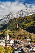 View of Ardez village surrounded by woods and snowy peaks, Lower Engadine, Canton of Graubunden, Switzerland, Europe