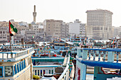 Transport boats lined up at Dubai Creek, Dubai, United Arab Emirates, Middle East