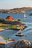View over red Swedish house and islands of archipelago, Skarhamn, Tjorn, Bohuslan Coast, southwest Sweden, Sweden, Scandinavia, Europe