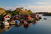 Red fishermen's huts by harbour and archipelago, Stocken, Orust, Bohuslan Coast, Southwest Sweden, Sweden, Scandinavia, Europe