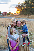Caucasian mother, grandmother and children smiling outdoors