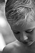 Young Boy Looking Down