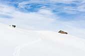 Group of people on a ski tour towards the hut, Fuocla da Cavadiras, Cavadiras hut, Disentis, Grisons, Switzerland