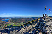Several persons standing at summit of Wallberg and looking towards lake Tegernsee, view from Wallberg, Wallberg, Bavarian Alps, Upper Bavaria, Bavaria, Germany