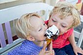 Children eating ice-cream, Bornholm is famous for its ice-cream, Baltic sea, MR, Bornholm, Gudhjem, Denmark, Europe