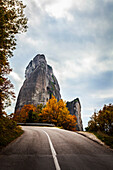 Rugged cliffs, road and autumn foliage, Meteora, Greece