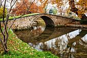 Stone bridge over a tranquil river, Edessa, Greece
