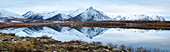 Mount Adney reflected in a pond along the Dempster Highway in the northern Yukon, Yukon, Canada