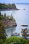 The Danny J Kachemak Bay Ferry cruises into Halibut Cove in Kachemak Bay, Southcentral Alaska, Summer