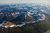 Aerial view of snow covered peaks along the Turnagain Arm in the Chugach Mountains, Southcentral Alaska, USA, Summer