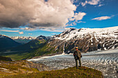 A man hiking near the Harding Ice Field Trail in Kenai Fjords National Park on the Kenai Peninsula in South Central Alaska