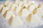 White chocolate pyramids with gold flakes on top, Toronto, Ontario, Canada