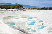 Tourists at the mineral rich pools and hot springs, Pamukkale, Turkey