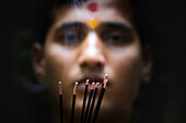Portrait of a Hindu Priest with incense sticks, Goa, India