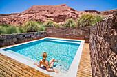Woman at a swimming pool, Atacama Desert, Chile, South America