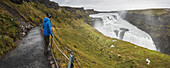 Tourist at Gullfoss Waterfall in the canyon of the Hvita River, The Golden Circle, Iceland, Polar Regions