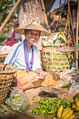 Portrait of a vendor at Ywama Village Market, Inle Lake, Shan State, Myanmar Burma, Asia