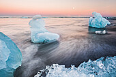 Icebergs at sunset on Jokulsarlon Beach, a black volcanic sand beach in South East Iceland, Iceland, Polar Regions