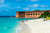 White sand beach and turquoise waters in front of Fort Jefferson, Dry Tortugas National Park, Florida Keys, Florida, United States of America, North America