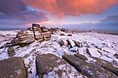 Colourful sunrise above snow covered moorland, Belstone Tor, Dartmoor, Devon, England, United Kingdom, Europe