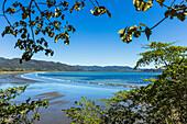 View from Tambor across Ballena Bay towards Pochote on the southern tip of the Nicoya Peninsula, Tambor, Puntarenas, Costa Rica, Central America